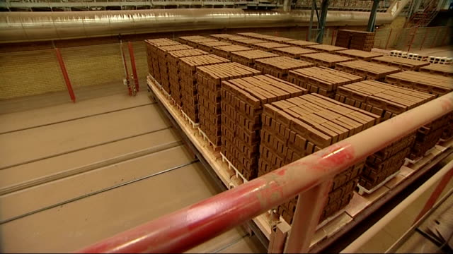 general views of hanson brick factory bricks along conveyor belts / stacks of bricks being moved along through factory / factory worker at controls /... - kiln stock videos and b-roll footage