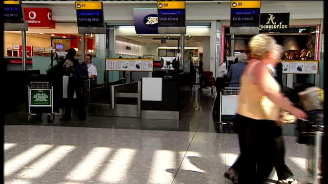 General views of Heathrow Terminal 5 ENGLAND London Heathrow Airport Terminal 5 INT Passengers in fairly quiet departure lounge at checkin desks...