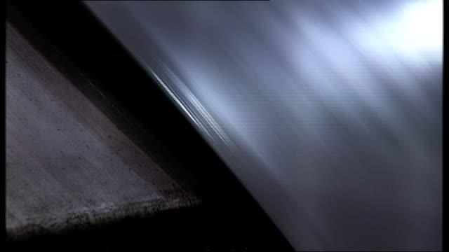 general views of honda plant in swindon doors along on conveyor belt and workers checking them / close shot conveyor belt / close shots of machinery... - ホンダ点の映像素材/bロール