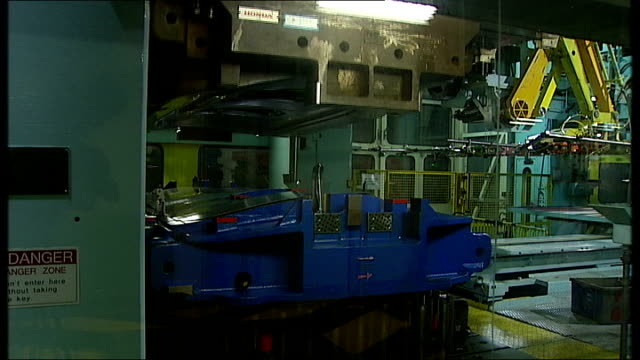 general views of honda plant in swindon more of engineers working on car chassis / gvs in electronic door stamping section / doors along on conveyor... - ホンダ点の映像素材/bロール
