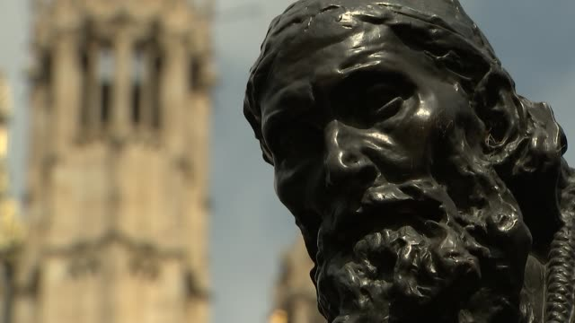 general views of houses of parliament long duration shot of the burghers of calais sculpture by auguste rodin with victoria tower in background /... - victoria tower stock videos & royalty-free footage