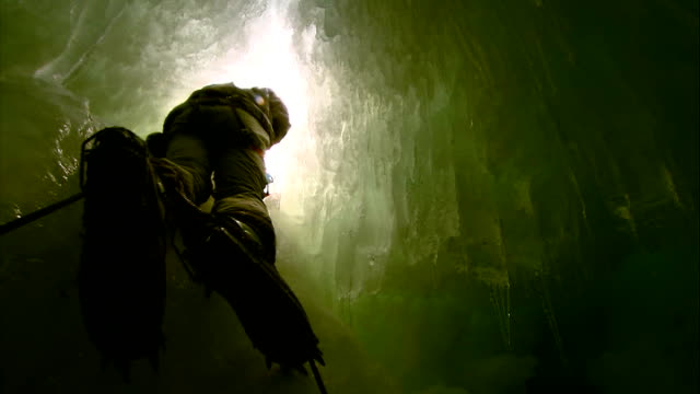 scientists' camp / crevasse abseiling / hms endurance back view of itv news correspondent mark austin abseiling into a crevasse the itv news... - human back stock videos & royalty-free footage