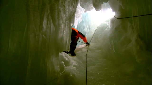 scientists' camp / crevasse abseiling / hms endurance back view of itv news correspondent lawrence mcginty climbing up crevasse along rope / itv... - human back stock videos & royalty-free footage