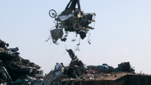 general views of junk being moved around at a uk scrapyard. - bad condition stock videos and b-roll footage