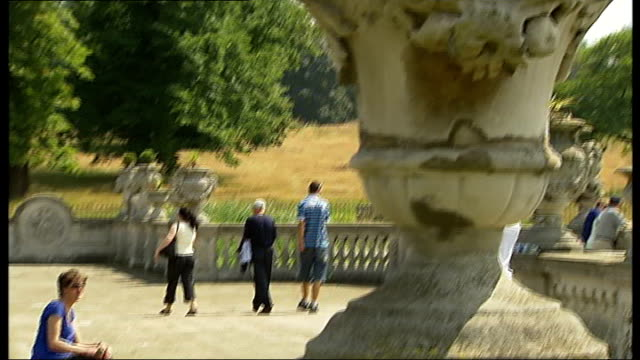 general views of kensington gardens; various of people around water fountains in the italian gardens / close up of water in fountain spraying up /... - aquatic organism stock videos & royalty-free footage