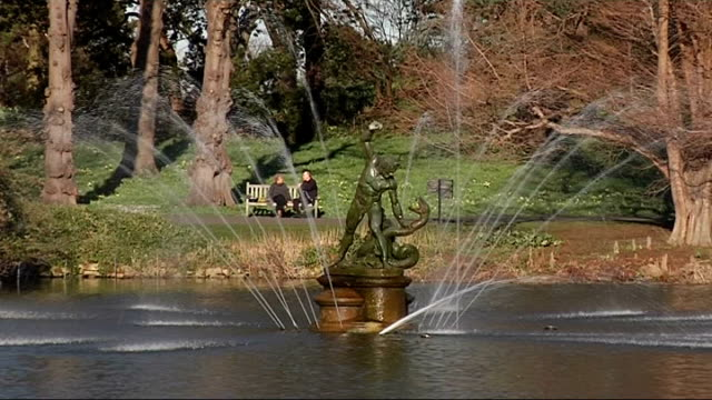 general views of kew gardens on a warm february day; henry moore sculpture 'large reclining figure' outside the palm house building / lake and... - キュー点の映像素材/bロール