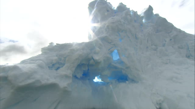 ice floes / crevasse / mountains more tracking shots of big ice floes with streaks of grey or browncoloured earth sediments / cormorant on ice - crevasse stock videos & royalty-free footage