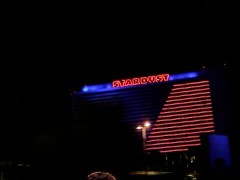 general views of las vegas casinos / sign for 'little white chapel' wedding venue; int car neon lights of casinos on las vegas strip , including... - the mirage las vegas stock videos & royalty-free footage