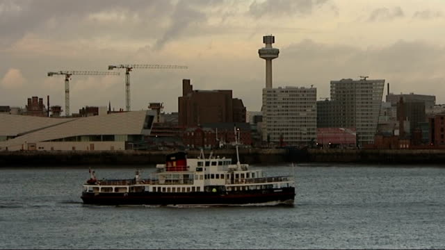 general views of liverpool: river mersey skyline / railway station / derelict buildings / residential tracking shots; ferry boat along in river with... - mersey ferry stock videos & royalty-free footage
