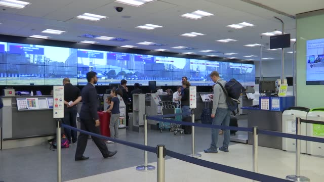 General views of London City Airport ENGLAND London INT People along in terminal departures area / passengers at check in / luggage being checked in...