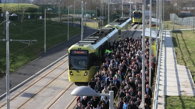 general views of manchesters new metrolink station outside manchester city football club as fans arrive for a match against leeds united in... - general view stock videos & royalty-free footage