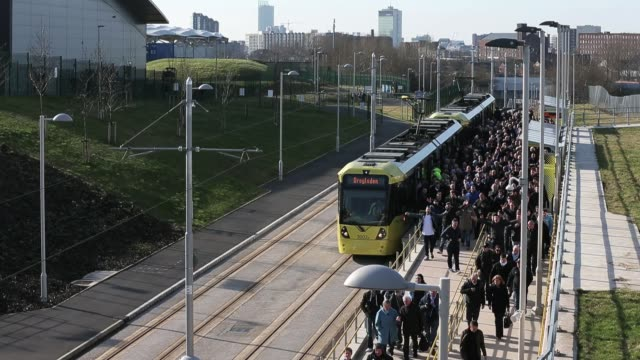 stockvideo's en b-roll-footage met general views of manchesters new metrolink station outside manchester city football club as fans arrive for a match against leeds united in... - leeds