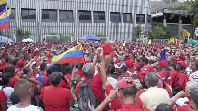 general views of members of local militia in red shirts and fatigues, marching, chanting and singing to show strength and support for maduro on... - camouflage stock videos & royalty-free footage