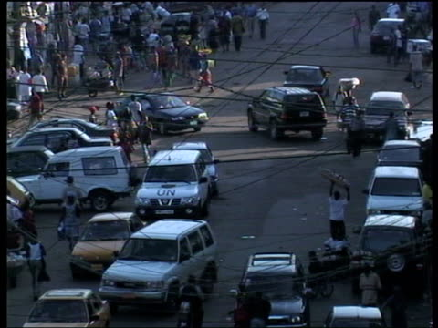 fuel shortages / street scenes High angle views of busy roads showing traffic and people along
