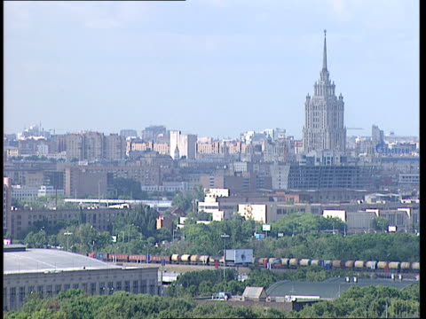 moscow ext general view moscow skyline with trees and park in foreground and showing the luzhniki stadium / city buildings including ministry of... - luzhniki stadium stock videos & royalty-free footage