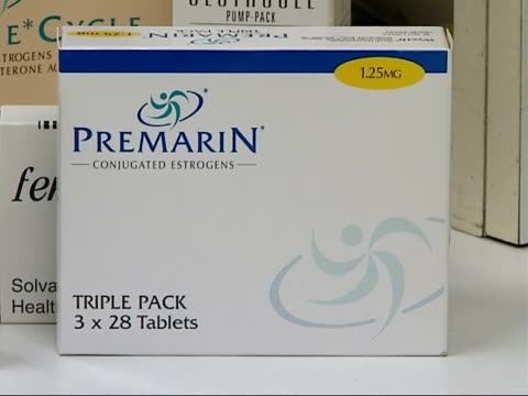 general views of new hrt drug premarin on display in chemist shop england london int various of packs of prempakc on display / close up of pack of... - hormone stock videos & royalty-free footage