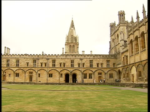 general views of oxford ext statue of eros in front of fountain / general view of christ church college courtyard pan / more of christ church... - oxford university stock videos & royalty-free footage