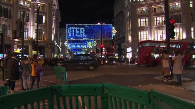 general views of oxford street christmas lights; england: london: oxford street: ext / night gvs banners with christmas lights with scrolling... - fairy lights stock videos & royalty-free footage