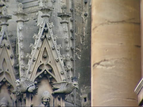 general views of oxford university buildings people along sculptures reliefs on side on university building / bicycle chained to railings / more of... - oxford university stock videos and b-roll footage