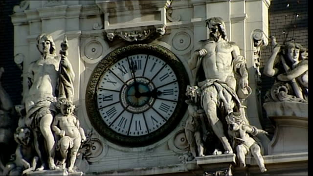 paris ext general views of hotel de ville / various of clock and statues on hotel de ville with 'liberte egalite fraternite' carved into facade **... - hotel de ville paris stock videos & royalty-free footage