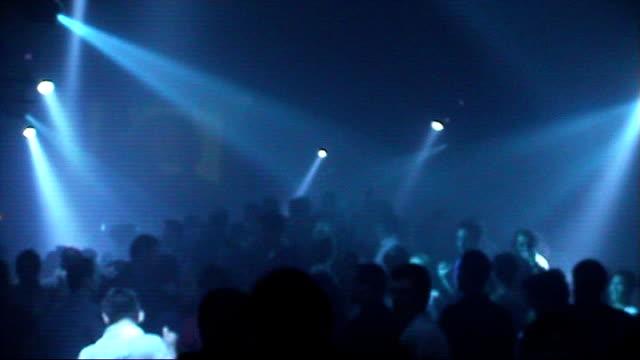 General views of people dancing in a nightclub Charing Cross Heaven nightclub LIGHTING * * Various of clubbers dancing on crowded dance floor lit up...