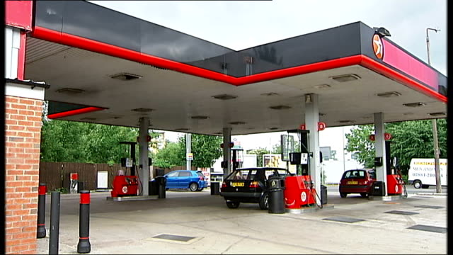 General views of petrol station / motorists and lorry drivers filling vehicles with fuel from pumps Texaco petrol station / motorist filling car with...