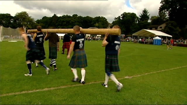general views of pitlochry highland games scotland perthshire pitlochry ext **music heard sot** general views of bagpipers along playing bagpipes at... - highland games stock videos & royalty-free footage