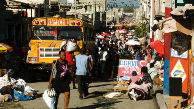 general views of port-au-prince one day before the anniversary of the magnitude 7.0 earthquake that struck just before 5 p.m. on jan. 12 destroying... - port au prince stock videos & royalty-free footage