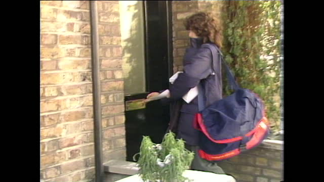 general views of postal workers delivering the uk government aids leaflets, which warn of the dangers of aids; 1987 - correspondence stock videos & royalty-free footage