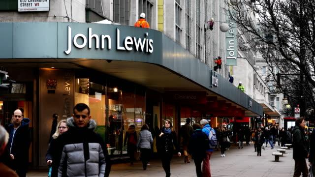 general views of retailers in oxford street london - oxford street london stock videos and b-roll footage
