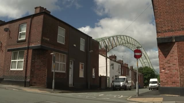 cheshire runcorn closed down and boarded up pub / houses on street / silver jubilee bridge span seen beyond houses / street sign waterloo road / sign... - sheet metal stock videos and b-roll footage