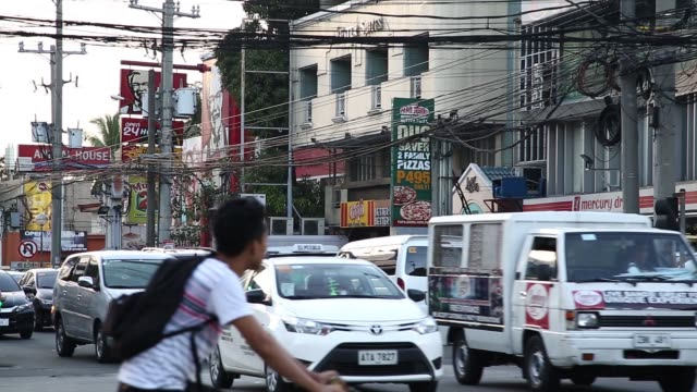 General views of rush hour traffic in the Makati district of Manila the Philippines on Friday Nov 20 A traffic officer directs traffic on a road in...