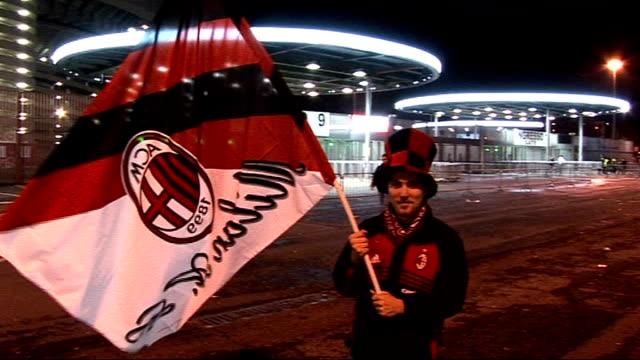 general views of san siro stadium and ac milan football fans; football fan wearing ac milan top hat and waving ac milan banner / various of football... - milan stock videos & royalty-free footage