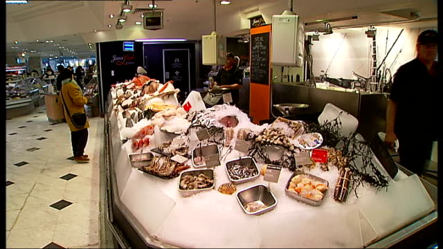 general views of selfridges department store customer examining bottles of wine / general view of food hall / charcuterie counter sausages and... - mullet fish stock videos & royalty-free footage
