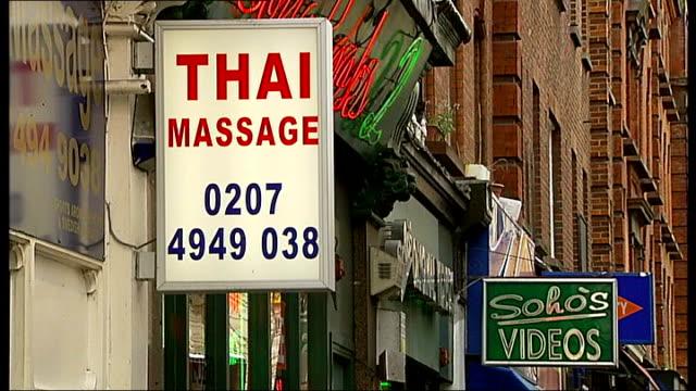 vidéos et rushes de general views of soho: street scenes, sex shops, signs; rundown exterior of former raymond revuebar / shop sign reading 'give adult toys for... - culture thaïlandaise