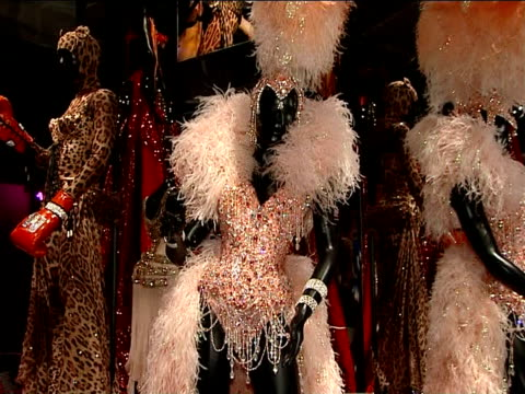 general views of stage costumes on display at kylie minogue exhibition england london victoria and albert museum int kylie minogue stage costumes on... - headdress stock videos and b-roll footage