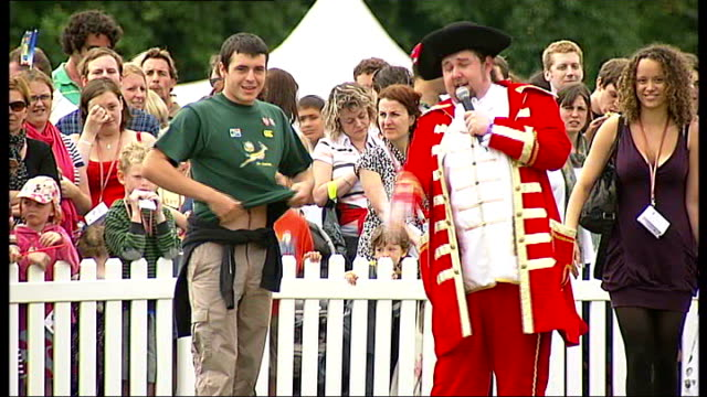 general views of summer fete including 'welly wanging' and helter skelter - gala stock videos & royalty-free footage