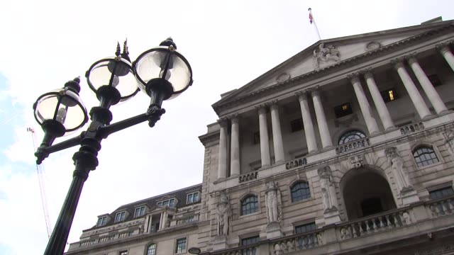General views of The City and Bank of England General views of Bank of England with cloudy blue sky overhead / statues on facade / people along /...