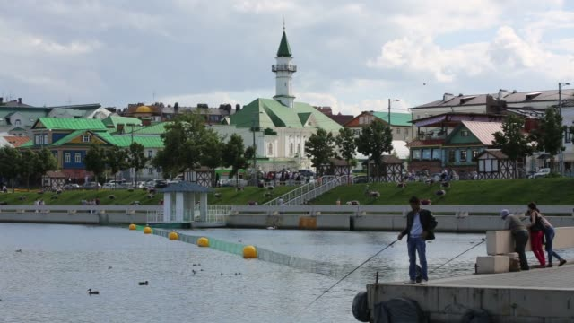 general views of the city of kazan russia on july 25 2015 shots people walk by corridor with church in the background a red sightseeing bus waits to... - kazan russia stock videos and b-roll footage