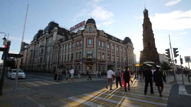 general views of the city of kazan russia on july 25 2015 shots wide shot of flowers and people sitting around with the sun and church in the... - kazan russia stock videos and b-roll footage