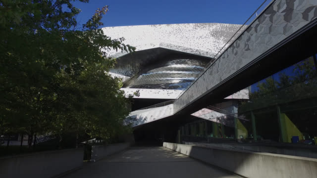 general views of the exterior of the philharmonie de paris which has closed during the second national lockdown as part of covid-19 measures to... - three people stock videos & royalty-free footage