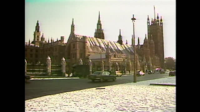 general views of the houses of parliament and big ben during the arctic freeze in the uk, january 1987. - tower stock videos & royalty-free footage