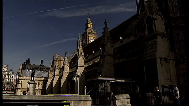 general views of the houses of parliament tourists and the london eye england london westminster general and low angle views of victoria tower /... - victoria tower stock-videos und b-roll-filmmaterial