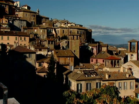 general views of the town of perugia, where the amanda knox trial is being conducted / view of houses on hillside, to valley beyond views of the town... - perugia stock videos & royalty-free footage