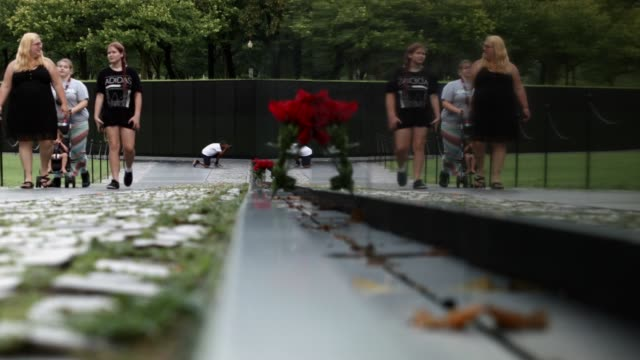 General views of the Vietnam Veterans Memorial on the National Mall August 8 2016 in Washington DC The Vshaped black granite wall bears the names of...