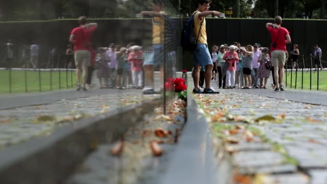 general views of the vietnam veterans memorial on the national mall august 8, 2016 in washington, dc. the v-shaped black granite wall bears the names... - vietnam veterans memorial video stock e b–roll