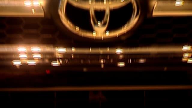 stockvideo's en b-roll-footage met general views of toyota car showroom england london int general views and close ups of new toyota cars in showroom including aygo rav4 verso and yaris - toyota motor