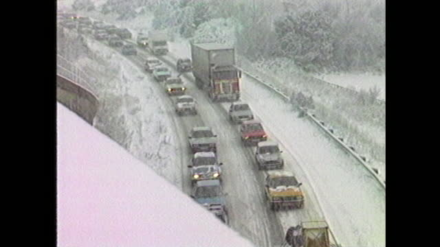 general views of traffic driving through heavy snow in eastern england during blizzards in january 1987. - frozen stock videos & royalty-free footage