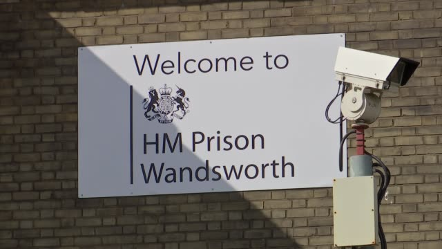 general views of wandsworth prison; england: london: hm prison wandsworth: ext gvs prison building entrance and windows / barbed wire fence /... - general view stock videos & royalty-free footage