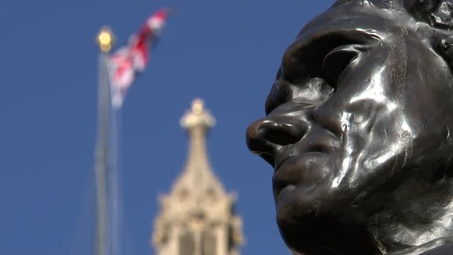 stockvideo's en b-roll-footage met general views of westminster on sunny day; england: london: westminster: ext houses of parliament and trees / seagull in front of london eye / the... - victoria tower